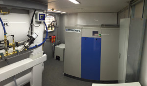 View of Mobile Equine Hyperbaric Therapy (MEHOT) plant room showing compressor